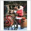 cross stitch pattern Santa Feeding the Reindeer